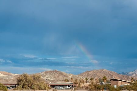 A relatively rare sighting of a rainbow over Furnace Creek, Death Valley, in the middle of Summer 版權商用圖片