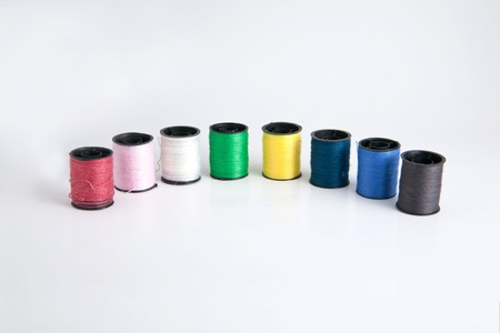 Roll thread used for sewing are available in various colors  photo