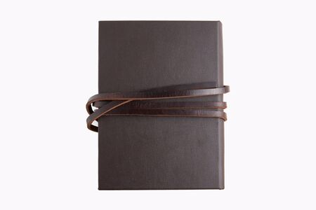 Secret brown leather book with white background. photo