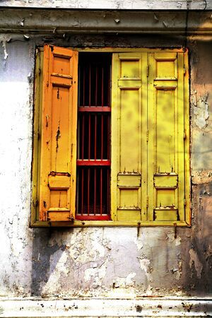 Old wooden door, the yellow part of the Thai temple  photo