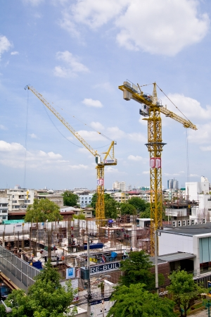BANGKOK, THAILAND - July 3: Crane and the two teams are working at the roadside in the city of Bangkok, Thailand on July 3, 2012.