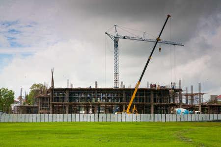 Phitsanulok, Thailand - July 11: Crane and the two teams are working. Building on campus in Phitsanulok, Thailand on 11 July 2012.