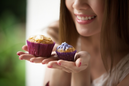 Woman holding a cup cake