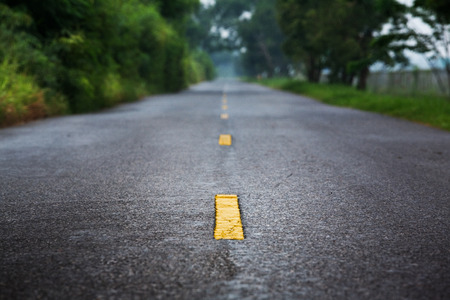 Paved road with yellow line traffic  Stock Photo