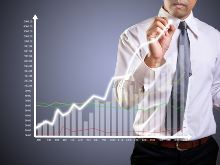Business man hand drawing a graph Stock Photo - 23576912