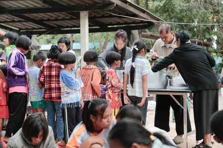 BURIRAM Province  - December 1  donations of goods and food to children in the community on December 1, 2013,Buriram province,thailand  Редакционное