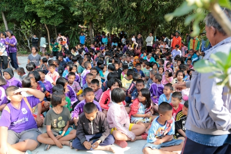 BURIRAM Province  - December 1  donations of goods and food to children in the community on December 1, 2013,Buriram province,thailand  Editorial