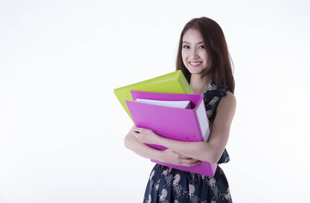 Young asian business woman holding file document  photo