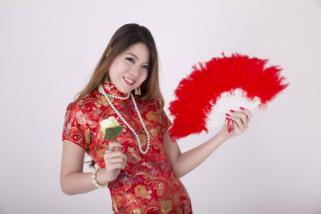 Sexy Chinese woman wear traditional dress cheongsam, isolated on white background  Stock Photo