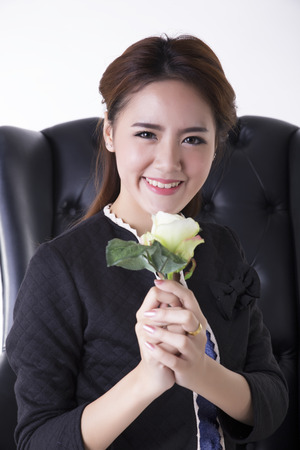 Woman holding a white rose photo