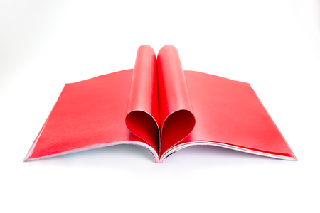 Red Letter folded into a heart shape on white background  photo