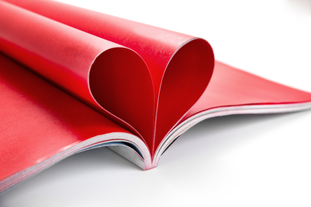 Red Letter folded into a heart shape on white background  Stock Photo