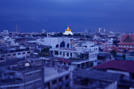 Night Urban City Skyline, Saket Temple  Golden mountain , Landmark of Bangkok, Thailand   photo
