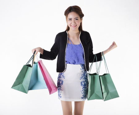 Asian girl holding shopping bags photo