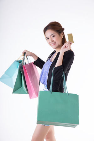 Asian girl holding shopping bags and credit cards  Stock Photo