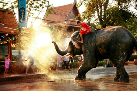 thai girl: AYUTTAYA, THAILAND - APRIL 15  Songkran Festival is celebrated in a traditional New Year Editorial