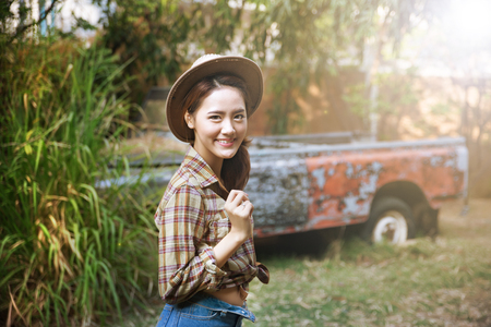 Asian woman wearing a cowboy hat and outdoor portraits  photo