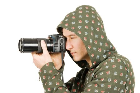 Photographer taking a shoot with a digital camera and a telephoto lens photo