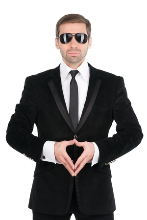 secret agent: Stylish bodyguard with glasses and folded arms. Isolated over white background