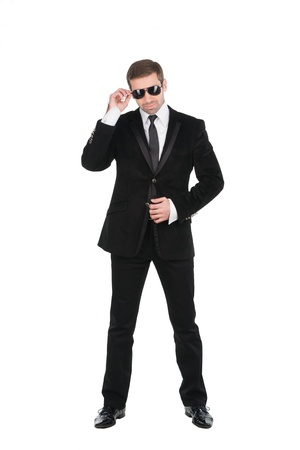 support agent: Stylish bodyguard with glasses and folded arms. Isolated over white background