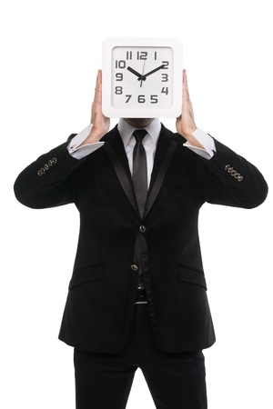portrait of young man holding a clock with his hands. Isolated on white. photo