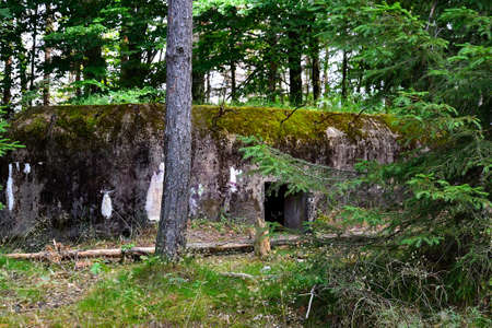 photographs of an abandoned concrete bunker, reminders of the Second World War and monuments of the military history of the Czech Republic from the 20th century