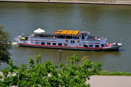 photo of a cruise ship on a cruise on the Wisla river in the historic city of Krakow, Poland,