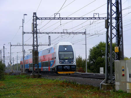 view of a double-decker electric train while running between the cities of northern Moravia, Czech Republic Stockfoto