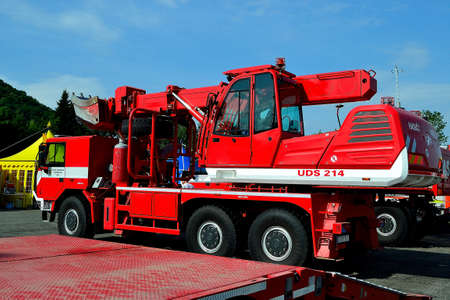 photo of a modern fire truck in the design of a universal finishing machine (UDS) on the occasion of a demonstration for the general public