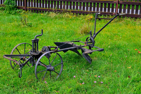 picture An old metal plow designed for towing a horse while plowing agricultural land