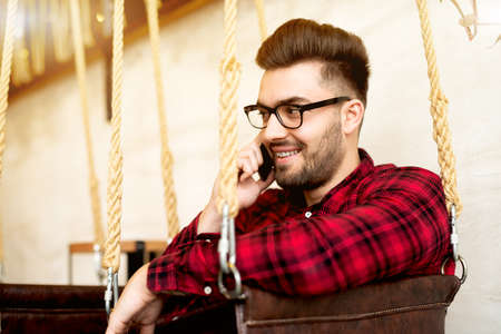 Handsome man talking on mobile phone.
