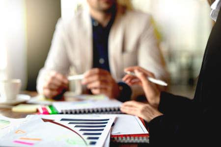 Successful business people analyzing market statistics.
