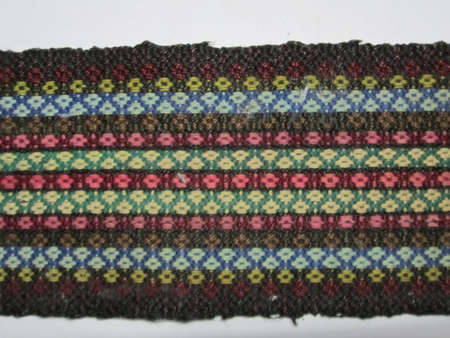 weaved: A colorful peace of weaved fabric which served as a belt in traditional clothing in many eastern european countries