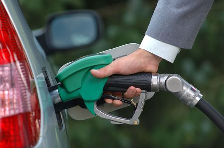 hand filling fuel photo