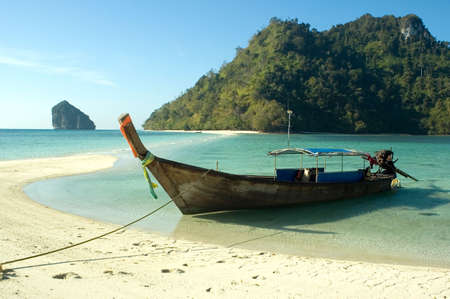 longtail boat on the beach