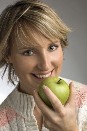 young woman eating green apple Stock Photo - 593557