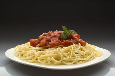 spghetti with tomato grawy on a plate photo