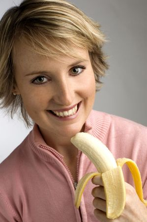 young woman eating banana Stock Photo - 596244