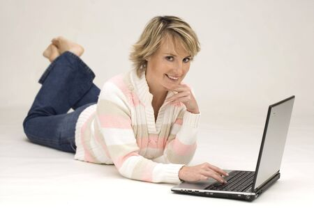 young woman typing on a laptop Stock Photo - 596245