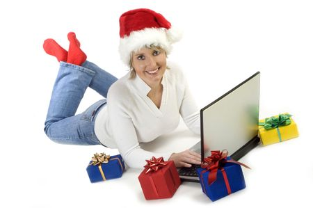 santa girl with christmas gifts and laptop on white Stock Photo - 622144