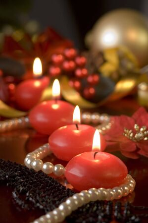 candles in front of decorated background close up photo