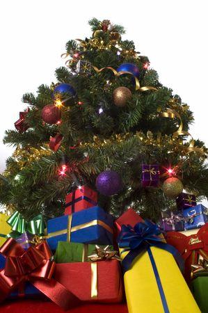 christmas presents under christmas tree on white Stock Photo