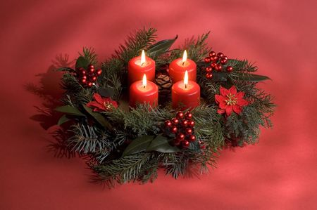 advent wreath on a red background close up
