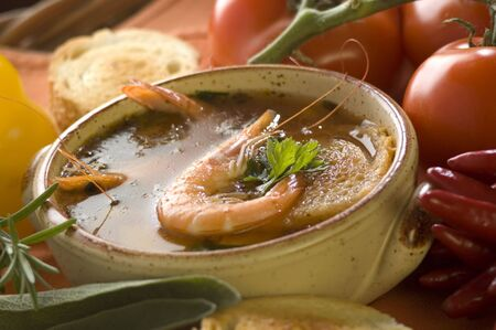 l first: prawn sea food soup with tomato close up