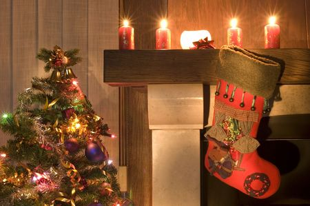 white stockings: Red christmas stocking hangs above the fireplace on Christmas