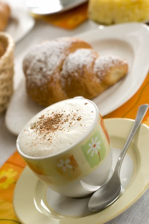 french Croissant on a plate with coffe in background photo