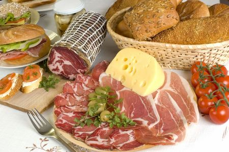 arranged prosciutto, olives cheese, bread and tomato close up Stock Photo
