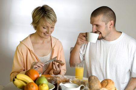young couple behind the table for breakfast Stock Photo - 680424