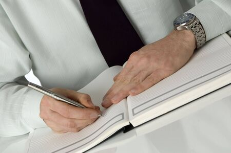 inherit: businessmen writing on note book close up shoot Stock Photo