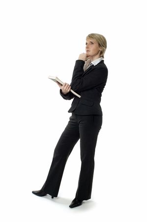 businesswear: business woman standing and looking up on white